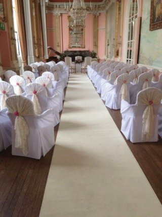 Danesfield Hotel set for a ceremony  with white covers for their armed chairs and the ivory  aisle carpet runner