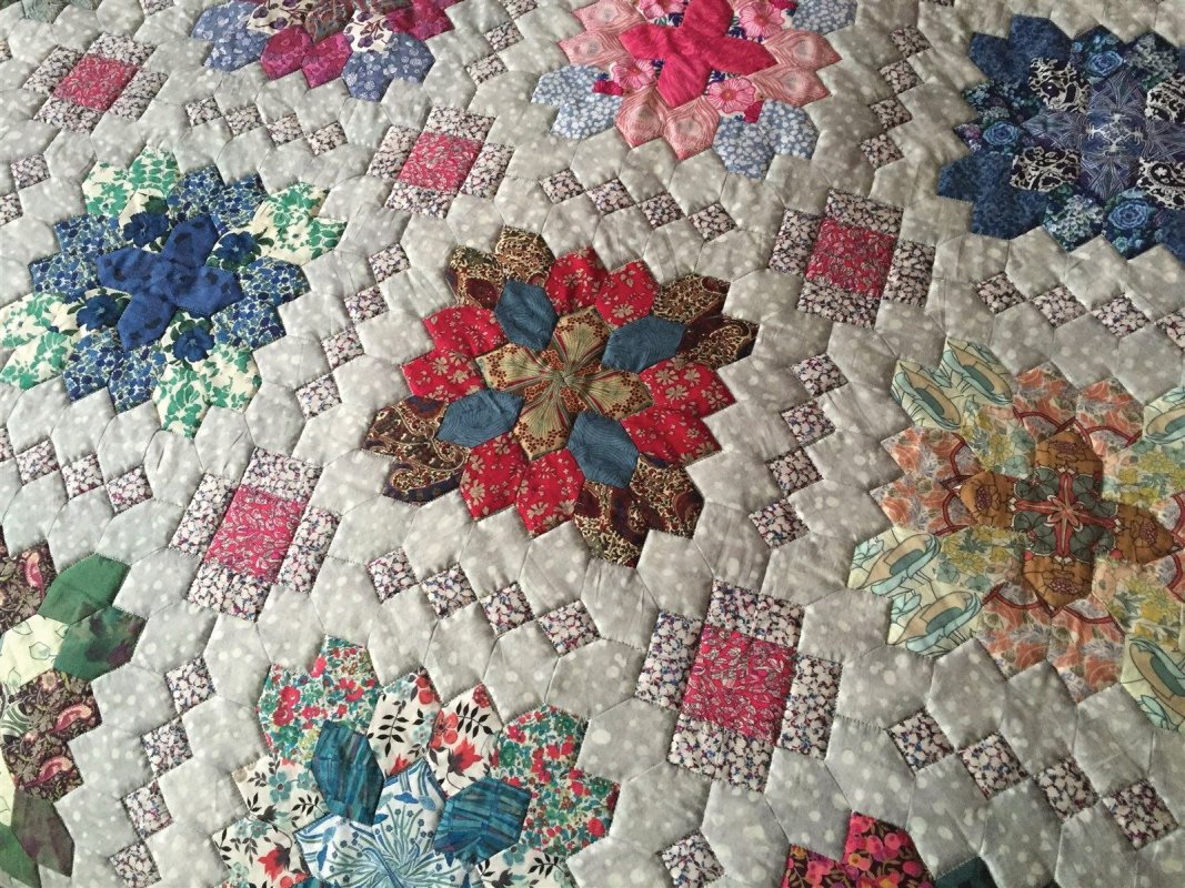 Liberty fabrics look stunning in this patchwork of the crosses design, pieced by Cynthia Dennis. Quilted by Janette Chilver